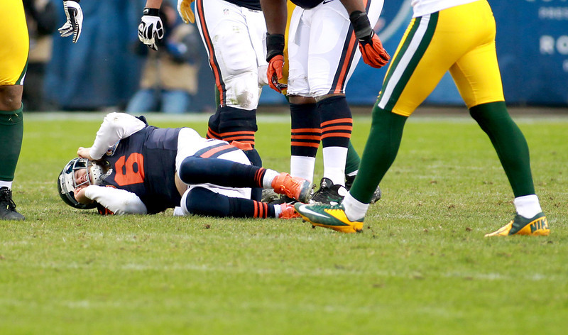 Chicago Bears quarterback Jay Cutler lays on the ground after getting sacked in the second half of their 21-13 loss to the Green Bay Packers at Soldier Field Sunday.(Sandy Bressner photo)