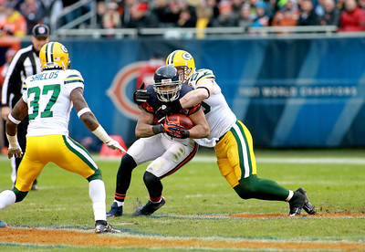 Chicago Bears running back Matt Forte is tackled in the first half of their 21-13 loss to the Green Bay Packers at Soldier Field Sunday.(Sandy Bressner photo)