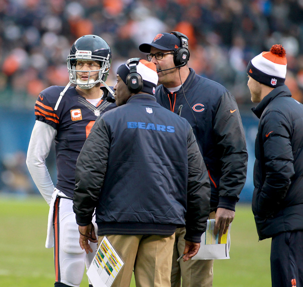Chicago Bears quarterback Jay Cutler talks to Head Coach Lovie Smith and Offensive Coordinator Mike Tice during the fourth quarter of their their 21-13 loss to the Green Bay Packers at Soldier Field Sunday.(Sandy Bressner photo)