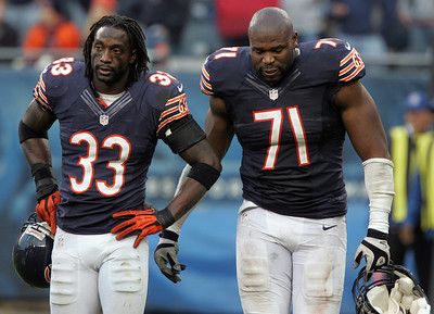 H. Rick Bamman - hbamman@shawmedia.com Charles Tillman (left) and Israel Idonije walk off the field after the Bear's loss to the Seattle Seahawks 21-17.