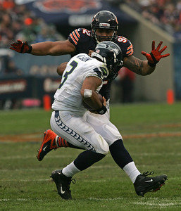 Monica Maschak - mmaschak@shawmedia.com Stephen Paea sacks Seattle quarterback Russell Wilson in the second half of Sunday's game at Soldier Field.  The Seahawks won 21-17 in overtime.
