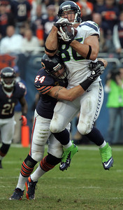 H. Rick Bamman - hbamman@shawmedia.com Brian Urlacher wraps up Seattle Seahawks' Zach Miller as he makes a catch in the fourth quarter in the Bears' loss 21-17 at Soldier Field Sunday, December 2, 2012.