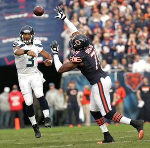 Monica Maschak - mmaschak@shawmedia.com Israel Idonije reaches to block a pass from Russell Wilson in the first half of Sunday's game. The Bears lost to the Seahawks 21-17 in overtime.