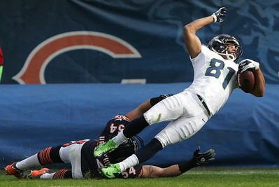Monica Maschak - mmaschak@shawmedia.com Seattle's Golden Tate is tackled by Chicago's Brian Urlacher in the first half of the game at Soldier Field on Sunday, December 2, 2012.  The Seahawks won 21-17 in overtime.