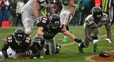 Monica Maschak - mmaschak@shawmedia.com Chicago's Craig Steltz (20) and Seattle's Sidney Rice (18) dive for a loose ball in the end zone after Golden Tate scores a touchdown in the fourth quarter of Sunday's game at Soldier Field.  The Bears lost to the Seahawks 21-17 in overtime.