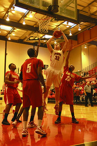 Pat McInerney goes up to take a shot for Benet on Saturday, Dec. 22. Sarah Minor — sminor@shawmedia.com