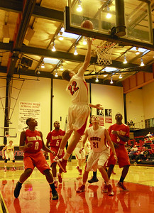 Jack Toner goes up for a lay up during Benet's first game of the Proviso West holiday tournament. Sarah Minor — sminor@shawmedia.com