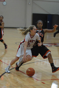 Benet Academy freshman guard Kathleen Doyle (21) drives to the basket during a semi-final game against DeKalb in the Naperville North/Benet Academy Girls Basketball Holiday Tournament at Benet Academy in Lisle on Thursday, Dec. 20, 2012. Matthew Piechalak — mpiechalak@shawmedia.com