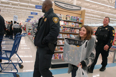 Allison Steward, 10, of Bolingbrook smiles after purchasing a gift during the annual Shop with a Cop event at Meijer, 755 E. Boughton Rd. on Tuesday, Dec. 18, 2012. Matthew Piechalak — mpiechalak@shawmedia.com
