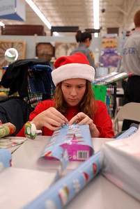 Volunteer Dariana Slater, 15, wraps a present during the annual Shop with a Cop event at Meijer, 755 E. Boughton Rd. on Tuesday, Dec. 18, 2012. Matthew Piechalak — mpiechalak@shawmedia.com