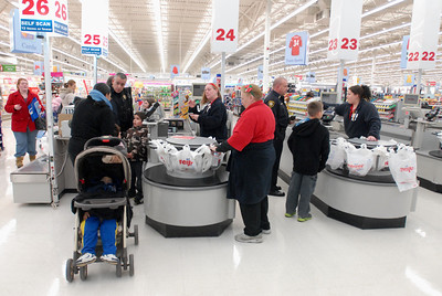Bolingbrook Police officers help children purchase their Christmas gifts during the annual Shop with a Cop event at Meijer, 755 E. Boughton Rd. on Tuesday, Dec. 18, 2012. Matthew Piechalak — mpiechalak@shawmedia.com