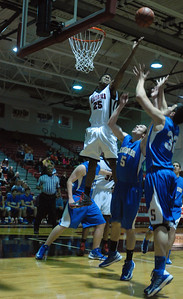 Bolingbrook guard Kendall Guyton (25) elevates to grab a rebound during a game against Sandburg on Friday, Dec. 7, 2012. Staff photo by Matthew Piechalak