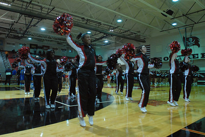 The Raiderettes cheer for the home crowd before a varsity boys basketball game between Bolingbrook and Sandburg on Friday, Dec. 7, 2012. Staff photo by Matthew Piechalak