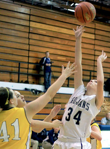 Sarah Nader - snader@shawmedia.com Cary-Grove's Morgan Lee (left) jumps for the rebound during the third quarter of Tuesday's game against Jacobs at Cary-Grove High School on December 18, 2012.