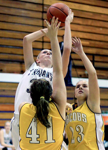Sarah Nader - snader@shawmedia.com Cary-Grove's Morgan Lee shoots over Jacobs' Nicole Cook during the second quarter of Tuesday's game at Cary-Grove High School on December 18, 2012.