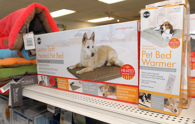 Heated pet beds and pet bed warmers are some of the pet gift options at Critters Pet Shop in St. Charles. Staff photo by Bill Ackerman