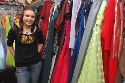 Claudia Sitko, 15, of St. Charles, poses inside Claudia's Closet, 217 W. Main St. on Friday, Dec. 28, 2012. Sitko, a freshman at St. Charles East High School, is a model who recently had photos of her from a Route 66 photo shoot accepted in Italian Vogue Magazine. Matthew Piechalak — mpiechalak@shawmedia.com.