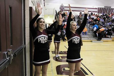 Sarah Nader - snader@shawmedia.com Prairie Ridge cheerleaders cheer on the boys basketball team during their game against Crystal Lake Central on Wednesday, December 5, 2012.