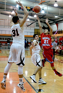 Sarah Nader - snader@shawmedia.com Marian Central's Derreck Caldez (right) shoots over Crystal Lake Central's Kyle Fleck during the first quarter of Tuesday's game in Crystal Lake on December 11, 2012.