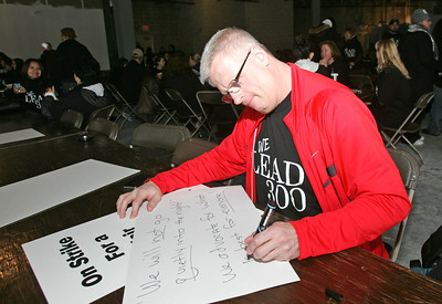 H. Rick Bamman - hbamman@shawmedia.com Striking Carpentersville Middle School teacher Kevin Ballard works on a sign at the union strike headquarters in West Dundee Tuesday. LEAD 300 declared the strike early Monday evening after negotiating with the district board for nearly eight hours.