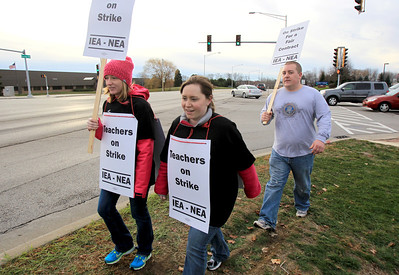 Sarah Nader - snader@shawmedia.com District 300 teachers were out of the classroom and in picket lines off Randall Road near Jacobs High School in Algonquin on Tuesday, December 4, 2012. District 300's teacher union announced Monday that all of it's 1,300 members will go on strike. Ongoing differences over compensation and class sizes have prolonged a tentative deal.