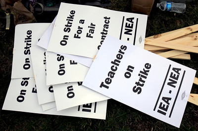 Sarah Nader - snader@shawmedia.com Picket signs used for the District 300 teachers strike are piled up near Jacobs High School in Algonquin on Tuesday, December 3, 2012.