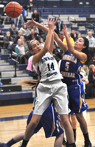 Claire Hardy of Downers Grove South battles for a rebound during their game against Aurora Central Catholic Thursday Dec. 27 at the Oswego East Holiday Classic Girls Basketball Tournament. Mark Busch — mbusch@shawmedia.com