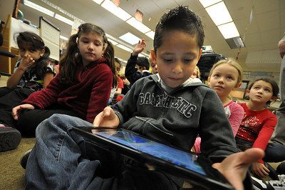 El Sierra second grader Emiliano Lagunas idenifies words in a paragraph using an iPad during English class Wednesday morning. Staff photo by John Cox
