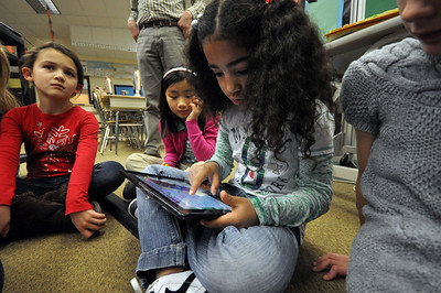 El Sierra second grader Teyani Sharkey idenifies words in a paragraph using an iPad during English class Wednesday morning. Staff photo by John Cox