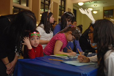 "Max Perez, 4, of North Riverside tells student-volunteer Fatima Morales, 14, what to write on his holiday ""letter of thanks"" at the 5th Annual Festival Invernal at the Morton Freshman Center, 1801 55th Ct. in Cicero on Wednesday, Dec. 5, 2012. The holiday-based literacy program featured games, art projects and a book give-away. Staff photo by Matthew Piechalak"
