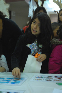 Ashley Orduna, 8, of Cicero plays a word sort game at the 5th Annual Festival Invernal at the Morton Freshman Center, 1801 55th Ct. in Cicero on Wednesday, Dec. 5, 2012. The holiday-based literacy program featured games, art projects and a book give-away. Staff photo by Matthew Piechalak