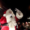 Santa Claus waves to the crowd during the annual Geneva Christmas Walk Friday night.(Sandy Bressner photo)