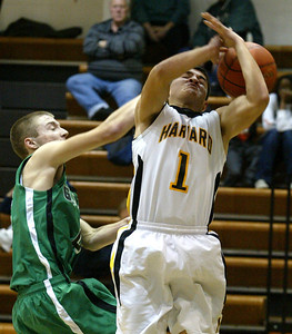 H. Rick Bamman - hbamman@shawmedia.com Alden-Hebron's Bryce Lalor knocks away a shot by Hebron's Fernando Carrera in the second quarter Monday, December 10, 2012 in Hebron.