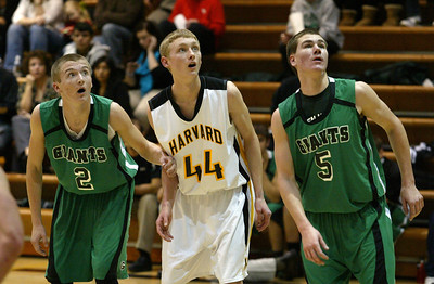 H. Rick Bamman - hbamman@shawmedia.com Alden-Hebron Bryce Lalor (left) and Ian Johnson (right) with Harvard's Erik Finke watch as a free throw spins on the rim in the second quarter.