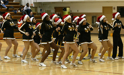H. Rick Bamman - hbamman@shawmedia.com Harvard cheerleaders perform at the half Monday, Dec. 10, 2012