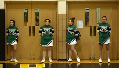 H. Rick Bamman - hbamman@shawmedia.com Alden-Hebron cheerleaders watch the action Monday, Dec. 10, 2012