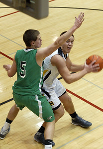 H. Rick Bamman - hbamman@shawmedia.com Alden-Hebron's Ian Johnson defends Harvard's Tate Miller under the basket in the first quarter Monday, Dec. 10, 2012.
