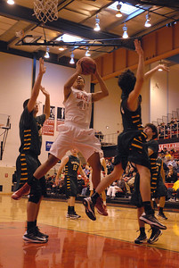 Glenbard East senior Tahron Harvey goes up for a shot during a first round game against Glenbrook North in the Proviso West Holiday Tournament in Hillside on Wednesday, Dec. 26, 2012. Matthew Piechalak — mpiechalak@shawmedia.com.