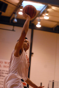 Glenbard East senior Tahron Harvey goes up for the shot during a first round game against Glenbrook North in the Proviso West Holiday Tournament in Hillside on Wednesday, Dec. 26, 2012. Matthew Piechalak — mpiechalak@shawmedia.com.