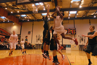 Glenbard East senior Marvin Grant-Clark goes up for a shot during a first round game against Glenbrook North in the Proviso West Holiday Tournament in Hillside on Wednesday, Dec. 26, 2012. Matthew Piechalak — mpiechalak@shawmedia.com.