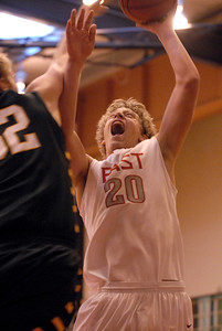 Glenbard East senior Greg Ludwig goes up for a shot during a first round game against Glenbrook North in the Proviso West Holiday Tournament in Hillside on Wednesday, Dec. 26, 2012. Matthew Piechalak — mpiechalak@shawmedia.com.