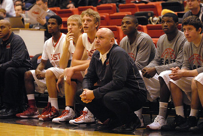 Glenbard East head coach Scott Miller and players on the bench watch a free throw attempt during a first round game against Glenbrook North in the Proviso West Holiday Tournament in Hillside on Wednesday, Dec. 26, 2012. Matthew Piechalak — mpiechalak@shawmedia.com.