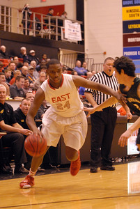 Glenbard East senior Marvin Grant-Clark drives to the lane during a first round game against Glenbrook North in the Proviso West Holiday Tournament in Hillside on Wednesday, Dec. 26, 2012. Matthew Piechalak — mpiechalak@shawmedia.com.