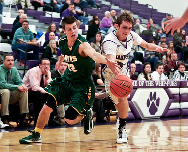 Josh Peckler - Jpeckler@shawmedia.com Crystal Lake Central's Nick Geske (32) and Hampshire's Brendan Waterworth go after a loose ball during the first quarter at Hampshire High School Tuesday, December 18, 2012.
