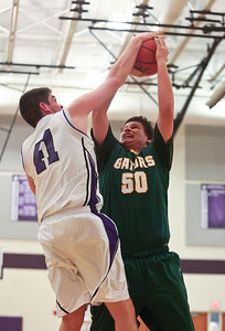 Josh Peckler - Jpeckler@shawmedia.com Hampshire's Shane Hernandez blocks the shot of Crystal Lake South's Max Meitzler during the first quarter at Hampshire High School Tuesday, December 18, 2012.