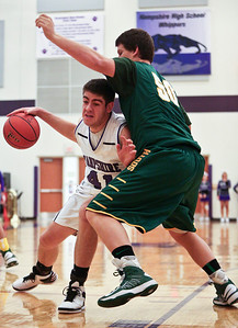 Josh Peckler - Jpeckler@shawmedia.com Hampshire's Shane Hernandez tries to drive the ball towards the basket while being guarded by Crystal Lake South's Max Meitzler during the first quarter at Hampshire High School Tuesday, December 18, 2012.