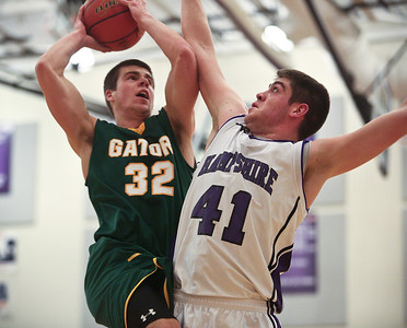 Josh Peckler - Jpeckler@shawmedia.com Hampshire's Shane Hernandez tries to block the shot of Crystal Lake South's Nick Geske during the third quarter at Hampshire High School Tuesday, December 18, 2012.