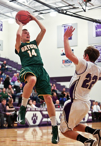 Josh Peckler - Jpeckler@shawmedia.com Crystal Lake South's Caleb Johnson leans back to shoot the ball after colliding with Hampshire's Brendan Waterworth during the second quarter at Hampshire High School Tuesday, December 18, 2012.
