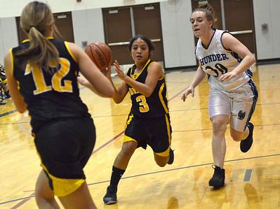 Monica Maschak - mmaschak@shawmedia.com Harvard's Jessica Hernandez passes the ball to her teammate Randi Blazier (left) in a game at Woodstock North High School on Monday, December 3, 2012. The Woodstock North Thunder won 43-24.