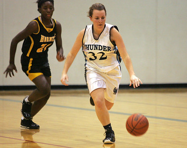 Monica Maschak - mmaschak@shawmedia.com Woodstock North's Jen Conley dribbles toward the hoop in a game against Harvard on Monday, December 3, 2012.  The Thunder beat the Hornets 43-24.